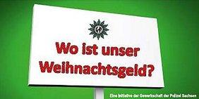 Schild mit GdP Logo und Aufschrift: Wo ist unser Weihnachtsgeld?